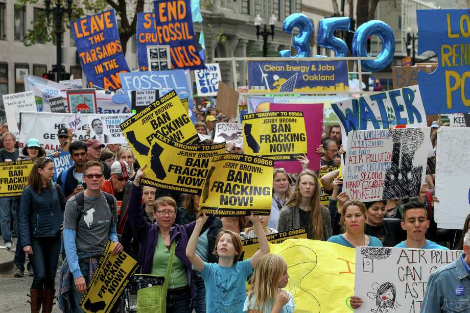 Protesters against fracking rallied at Frank H. Ogawa Plaza and marched for two miles to Lake Merritt Boulevard, Saturday, Feb. 7, 2015, in Oakland, Calif. Photo: Santiago Mejia / The Chronicle / ONLINE_YES