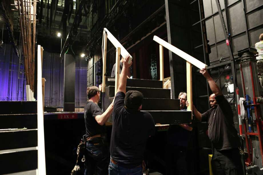 "The backstage crew works at assembling the set for the opera  ""Madame Butterfly"" after swapping out ""The Magic Flute"" set Friday at the Houston Grand Opera. Photo: Mayra Beltran, Staff / © 2015 Houston Chronicle"