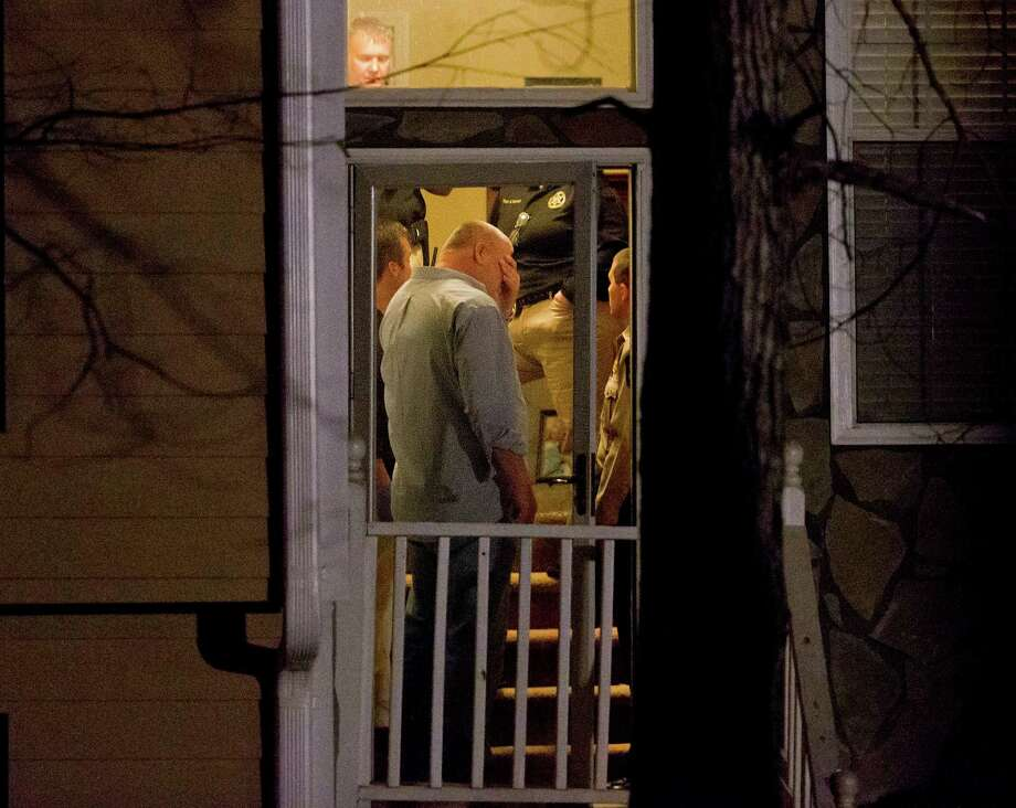 Authorities investigate a shooting Saturday in which five people were killed including the gunman inside a two-story home in Douglasville, Ga. Photo: David Goldman, STF / AP