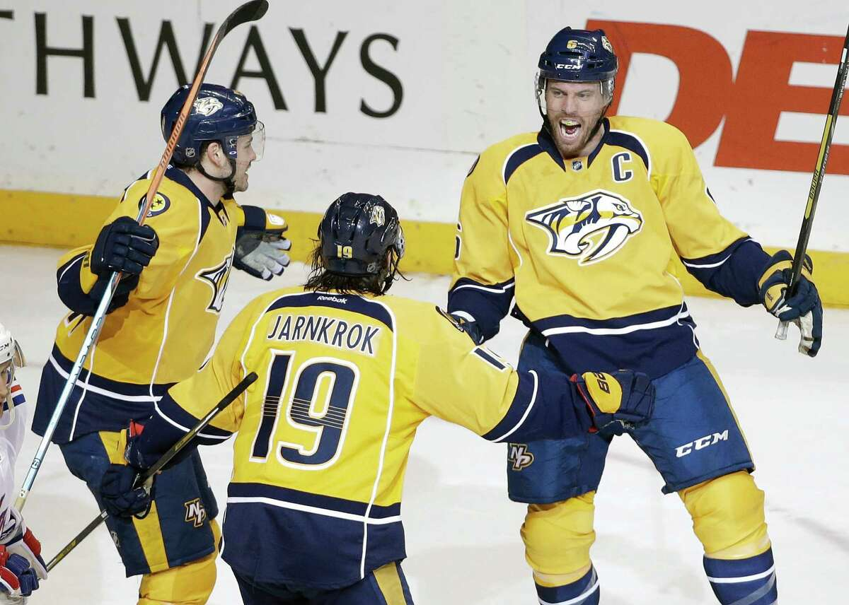 Nashville Predators defenseman Shea Weber, right, celebrates with Calle Jarnkrok (19), of Sweden, and Taylor Beck, left, after Weber scored a goal against the New York Rangers in the second period of an NHL hockey game, Saturday, Feb. 7, 2015, in Nashville, Tenn. (AP Photo/Mark Humphrey) ORG XMIT: TNMH109