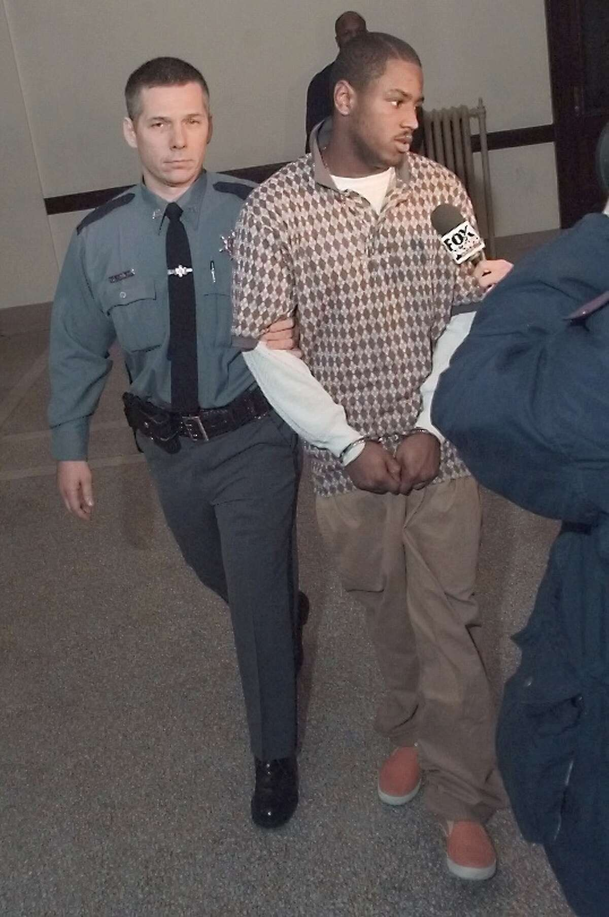 Carl Dukes is taken away after being sentenced to 37 years to life in prison in January 1999. Dukes told a judge he was wrongly convicted and pressured by police into signing a confession for the killing.