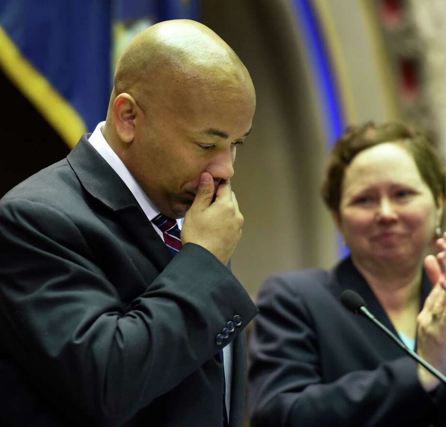 Speaker Carl Heastie is overcome by emotion on the podium after being elected as the new Speaker of the NYS Assembly Tuesday afternoon Feb. 3, 2015 at the Capitol in Albany, N.Y.          (Skip Dickstein/Times Union) Photo: SKIP DICKSTEIN / 00030435A