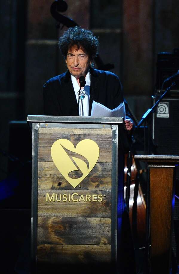 Bob Dylan accepts the 2015 MusiCares Person of the Year award on stage at the 2015 MusiCares Person of the Year show at the Los Angeles Convention Center on Friday, Feb. 6, 2015, in Los Angeles. (Photo by Vince Bucci/Invision/AP) Photo: Vince Bucci, INVL / Invision