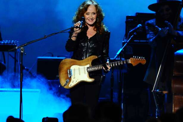 Bonnie Raitt performs on stage at the 2015 MusiCares Person of the Year show at the Los Angeles Convention Center on Friday, Feb. 6, 2015, in Los Angeles. (Photo by Vince Bucci/Invision/AP)