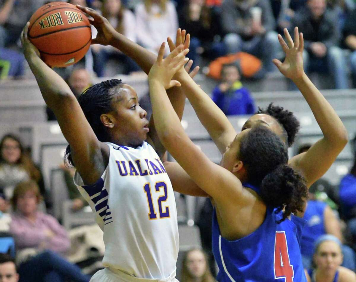 UAlbany's #12 Imani Tate, left, is double teamed by UMass-Lowell defenders during Saturday's game at the SEFCU Arena Feb. 7, 2015, in Albany, NY. (John Carl D'Annibale / Times Union)