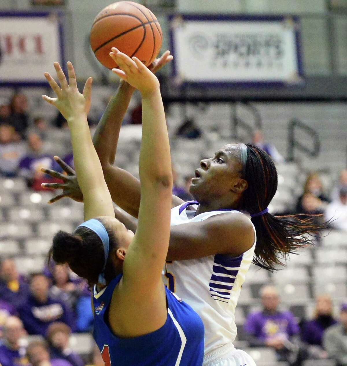 UAlbany's #25 Shereesha Richards, right, gets a shot past UMass-Lowell's #1 Kayla Gibbs during Saturday's game at the SEFCU Arena Feb. 7, 2015, in Albany, NY. (John Carl D'Annibale / Times Union)