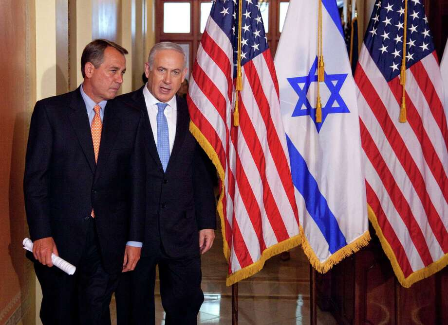 FILE - In this May 24, 2011 file photo, Israeli Prime Minister Benjamin Netanyahu walks with House Speaker John Boehner of Ohio on Capitol Hill in Washington. Israel's ambassador to the US has gotten an earful from a half-dozen House Democrats angered by Prime Minister Benjamin Netanyahu's acceptance of a Republican invitation to address Congress next month. Boehner's invitation came with the Obama administration in negotiations with Iran over its nuclear program. Boehner's move has angered the White House and Democrats.  (AP Photo/Evan Vucci, File) ORG XMIT: WX107 Photo: Evan Vucci / AP
