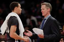 Warriors coach Steve Kerr (right) and Stephen Curry, talking in the first half, were both the subject of discussion heading into Sunday's game. Curry has performed well at Madison Square Garden, including a 54 point game, and Kerr nearly became the coach of the Knicks before deciding to accept Golden State's offer.