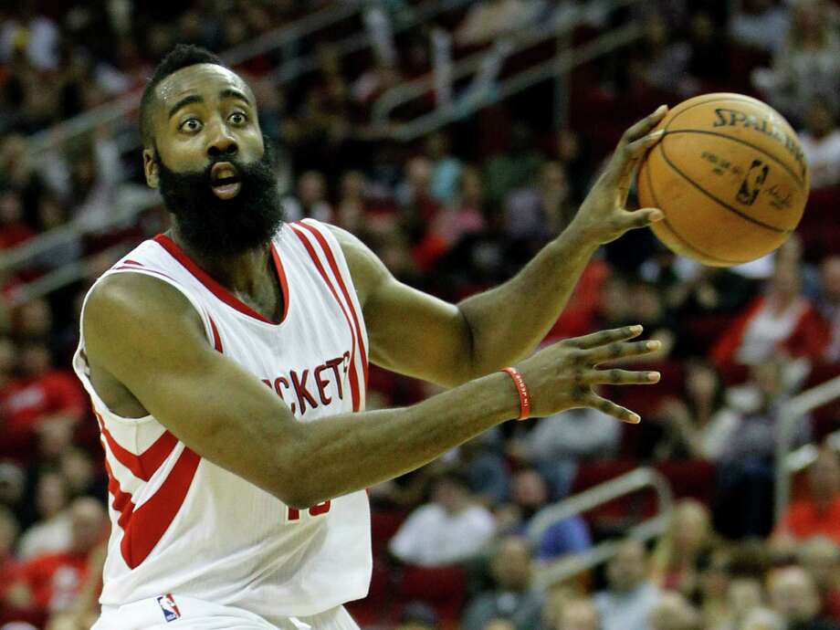 With no-look passing among his special talents, there is much more to James Harden's game than just scoring. The Rockets guard averages 27.1 points per game, but he also averages 5.5 rebounds, 6.7 assists and two steals. Photo: Karen Warren, Staff / © 2014 Houston Chronicle
