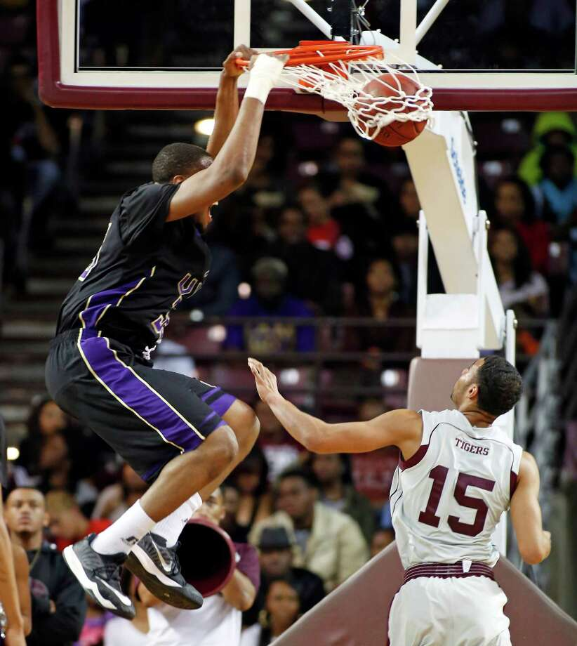 Basketball action from Texas Southern University vs. Prairie View at TSU tonight. first period ID: Prairie View #30 Karim York finally gets a clear shot at the basket and shows off his slam. Saturday February 07, 2015 Photo: Craig Hartley, For The Chronicle / Copyright: Craig H. Hartley