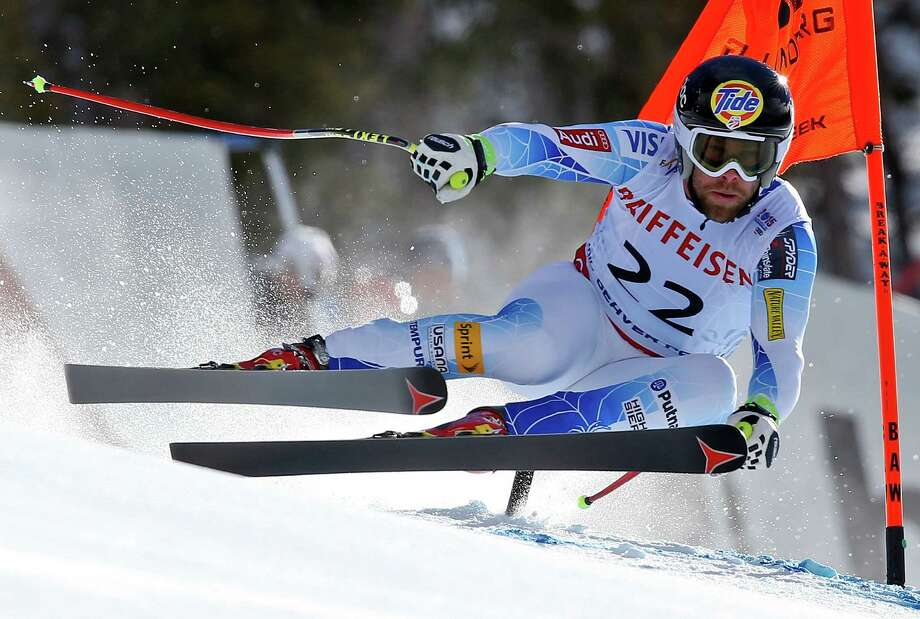 Travis Ganong of the United States lives life on the edge as he races to a second-place finish in the men's downhill Saturday at the Alpine World Championships at Beaver Creek, Colo. Photo: Alessandro Trovati, STR / AP