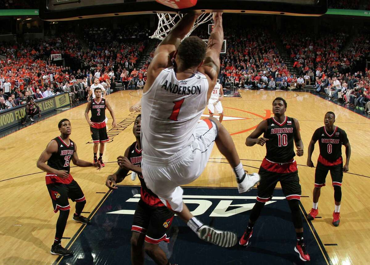 Louisville defenders watch as Virginia guard Justin Anderson (1) dunks the ball during the second half of an NCAA college basketball game Saturday Feb. 7, 2015, in Charlottesville, Va. Virginia defeated Louisville 52-47. (AP Photo/Andrew Shurtleff) ORG XMIT: VAAS113