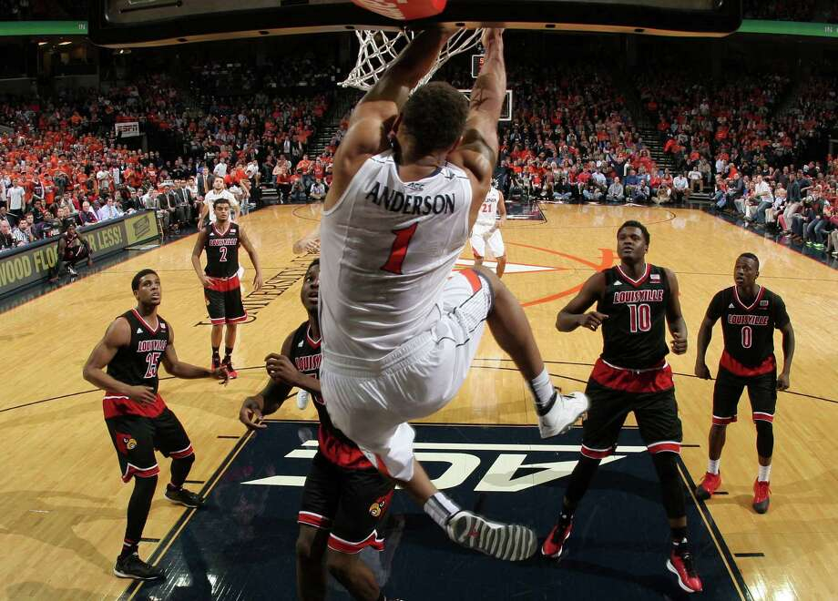 Louisville defenders watch as Virginia guard Justin Anderson (1) dunks the ball during the second half of an NCAA college basketball game Saturday Feb. 7, 2015, in Charlottesville, Va. Virginia defeated Louisville 52-47. (AP Photo/Andrew Shurtleff) ORG XMIT: VAAS113 Photo: Andrew Shurtleff / FR82550 AP