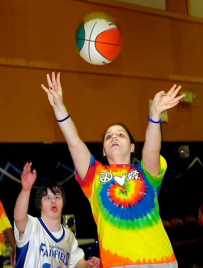 Olivia Shea of the Stamford Black Knights Unified Sports basketball team launches a shot during a game against Fairfield Ludlowe at St. Luke's School,  Monday afternoon, March 2nd, 2010, during a Unified Sports basketball tournament at the school.  Unified Sports follows the United Sports Model which is part of a Special Olympics program in which the teams are comprised of middle- and high-school athletes with developmental disabilities and volunteers who may or may not have a disability.  About a dozen team from Fairfield County competed in the tournament. Photo: Amy Mortensen / Connecticut Post