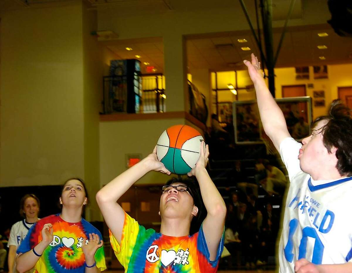 Stamford Black Knight Arrian Velasco, center, in action during the Unified Sports Basketball Tournament at St. Luke's in New Canaan.