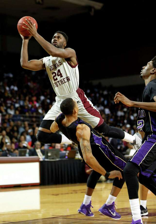 Basketball action from Texas Southern University vs. Prairie View at TSU tonight. first period ID: TSU #24 Nevin Johnson launches himself over Prairie View #1 Jayrn Johnson for two points. Saturday February 07, 2015 (Craig H. Hartley/For the Chronicle) Photo: Craig Hartley, Freelance / Copyright: Craig H. Hartley