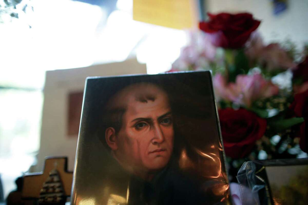 In this Jan. 27 , 2015 image, a portrait of Franciscan missionary Junipero Serra can be seen in the gift shop of the Mission San Diego de Acala in San Diego, Calif. Pope Francis' announcement that he will canonize Serra is meeting resistance by some in California and beyond, as critics say he wiped out native populations, enslaved converts and spread disease. (AP Photo/Gregory Bull)