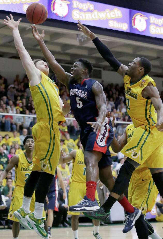 Gonzaga guard Gary Bell Jr. (5) shoots between San Francisco's Matt Christiansen, left, and Uche Ofoegbu during the first half of an NCAA college basketball game in San Francisco, Saturday, Feb. 7, 2015. (AP Photo/Jeff Chiu) Photo: Jeff Chiu / Associated Press / AP