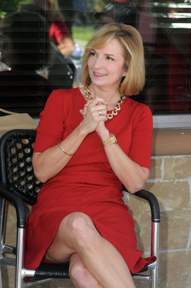 GOP candidate Devon Anderson listens to speakers during a rally for voters and supporters of Senate District 7 (SD-7) on the patio of Hasta La Pasta in Spring on Saturday. Photo: Jerry Baker, Freelance
