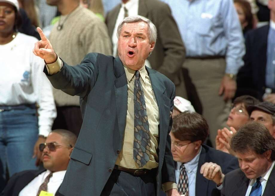 Dean Smith won 879 games, setting a men's Division I record later broken by Bob Knight and then Mike Krzyzewski. Photo: Doug Pensinger / Getty Images / Getty Images North America