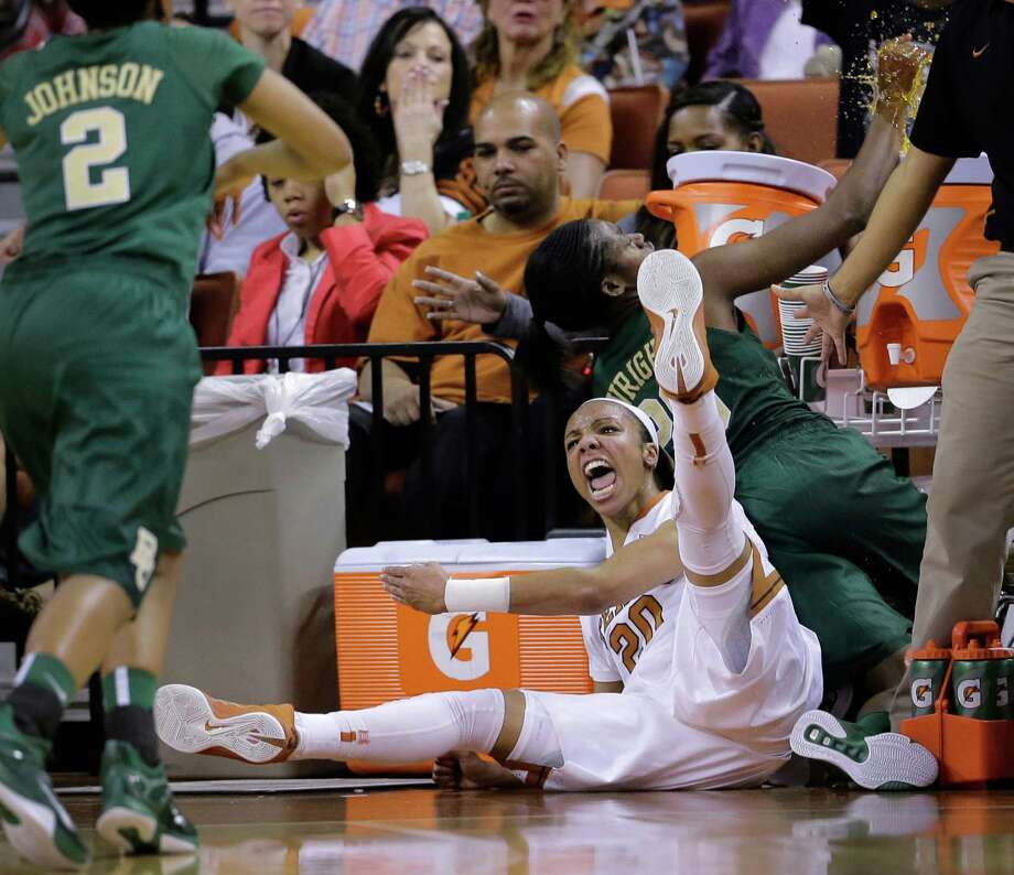 Texas' Brianna Taylor (20) and Baylor's Imani Wright, right, crash out of bounds while chasing after the ball during the second half of an NCAA college basketball game, Sunday, Feb. 8, 2015, in Austin, Texas. Baylor won 70-68. (AP Photo/Eric Gay) Photo: Eric Gay, Associated Press / AP