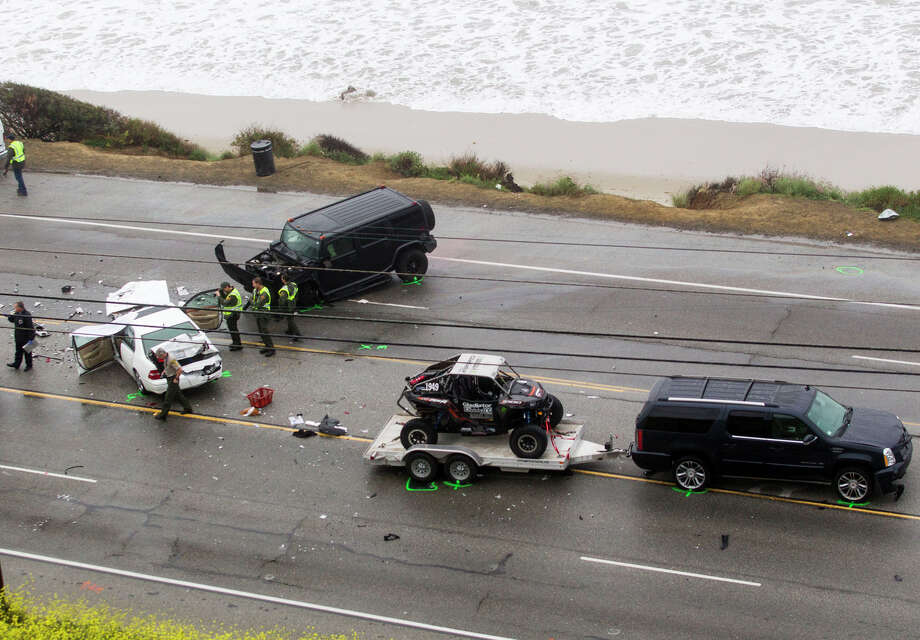 Los Angeles County sheriff's deputies investigate a car crash involving Bruce Jenner on Saturday that killed a 69-year-old woman where a the scene of a car crash where one person was killed and at least seven other's were injured, Saturday, Feb. 7, 2015. Olympic gold medalist Bruce Jenner was in one of the cars involved in the four-vehicle crash on the Pacific Coast Highway in Malibu, Calif., that killed a woman, Los Angeles County authorities said. (AP Photo/Ringo H.W. Chiu) Photo: Ringo H.W. Chiu / Associated Press / FR170512 AP