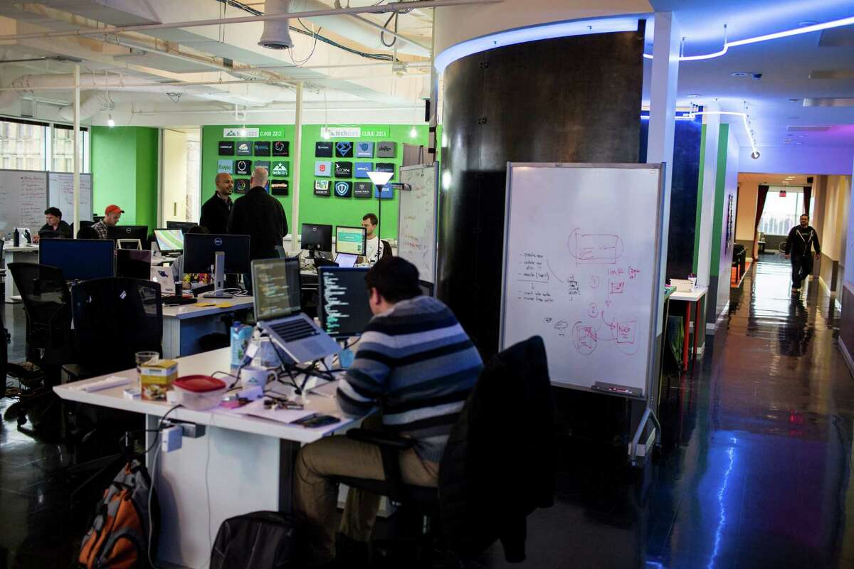 Members of several tech startup companies work in Techstars at the Weston Center in San Antonio on Wednesday, February 4, 2015.