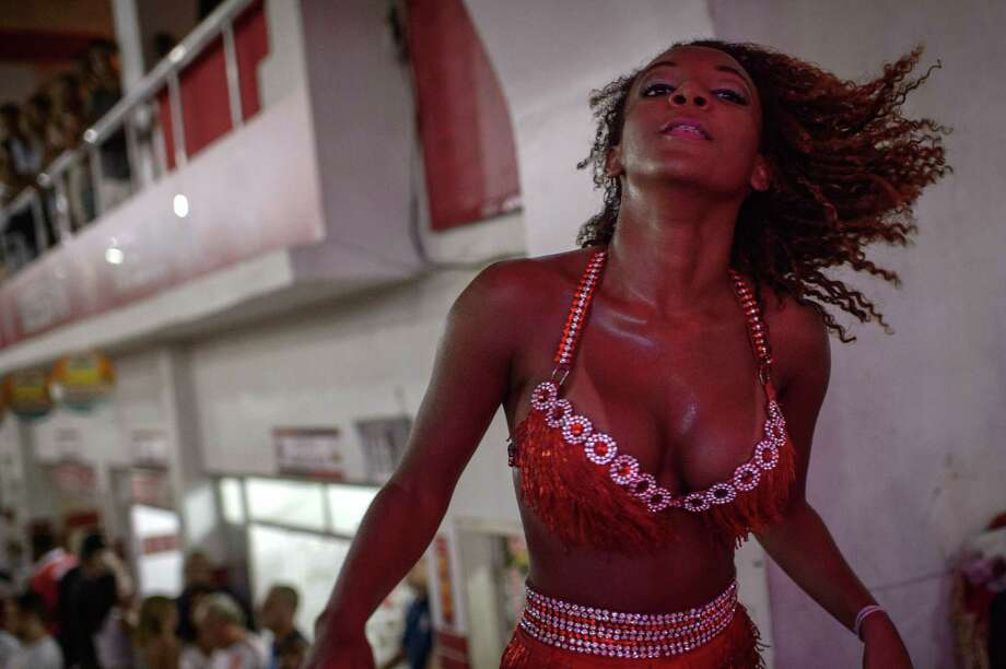 A Salgueiro samba school dancer stands by during a group's rehearsal for the upcoming carnival in Rio de Janeiro, Brazil, on February 1, 2014.  AFP PHOTO / YASUYOSHI CHIBA Photo: YASUYOSHI CHIBA, Getty Images / AFP