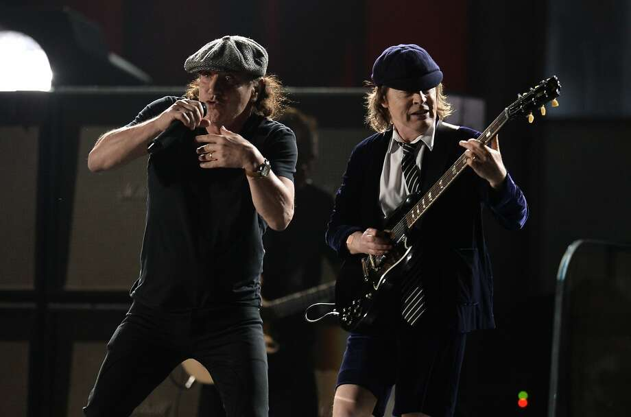 AC/DC perform on stage at the 57th Annual Grammy Awards in Los Angeles February 8, 2015. AFP PHOTO/ROBYN BECKROBYN BECK/AFP/Getty Images Photo: Robyn Beck, AFP / Getty Images