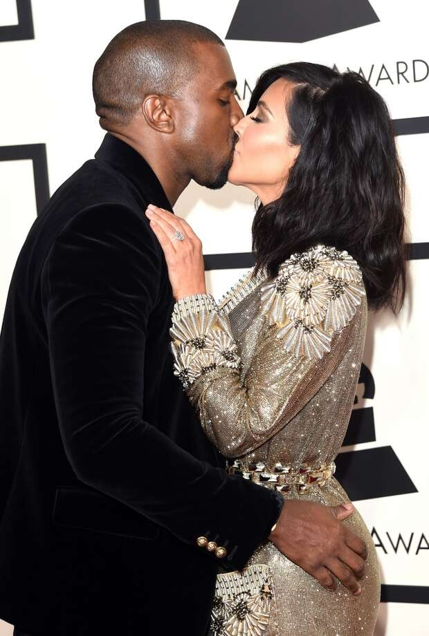 Rapper Kanye West (L) and TV personality Kim Kardashian attend The 57th Annual GRAMMY Awards at the STAPLES Center on February 8, 2015 in Los Angeles, California.  (Photo by Jason Merritt/Getty Images) Photo: Jason Merritt, Getty Images