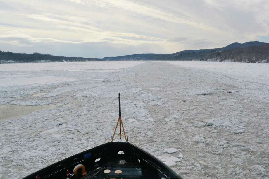 A view looking south on the Hudson River aboard the U.S. Coast Guard Cutter Thunder Bay on Thursday, Feb. 5, 2015, in Rhinecliff, N.Y.  The ship out of Rockland, Maine, is working to keep the Hudson River shipping channel clear of ice for crude oil coming out of Canada and hearing oil being shipped up to Albany.    (Paul Buckowski / Times Union) Photo: Paul Buckowski / 00030471A