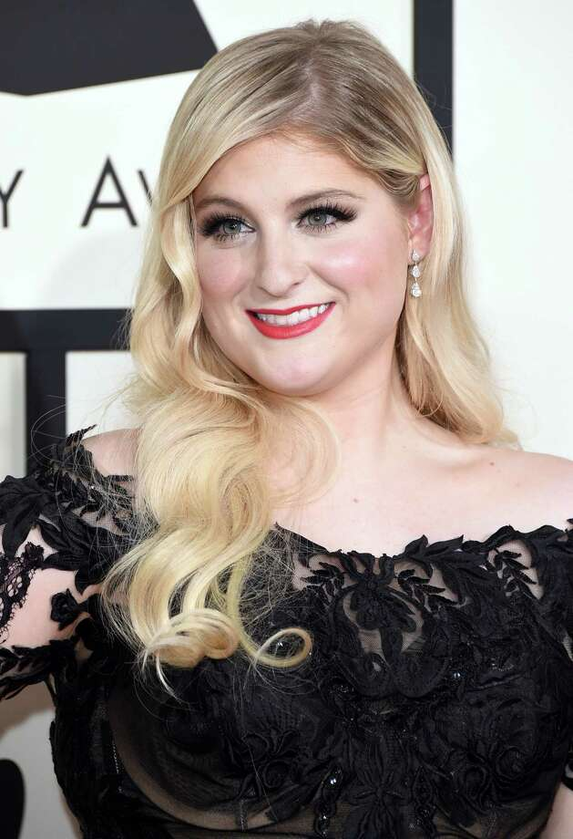 Meghan TrainorOn stage at the American Music Awards, she planted a huge wet kiss on singer Charlie Puth. No word on whether her lips were movin'. Photo: Jason Merritt, Staff / 2015 Getty Images