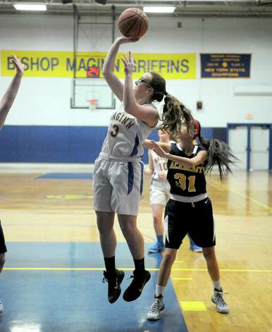 Maginn's Courtney Lane takes a shot during their girl's basketball game against Albany Academy on Thursday Feb. 5, 2015 in Albany, N.Y.  (Michael P. Farrell/Times Union) Photo: Michael P. Farrell / 10030488A