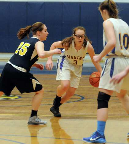 Maginn's Courtney Lane brings the ball up court during their girl's basketball game against Albany Academy on Thursday Feb. 5, 2015 in Albany, N.Y.  (Michael P. Farrell/Times Union) Photo: Michael P. Farrell / 10030488A
