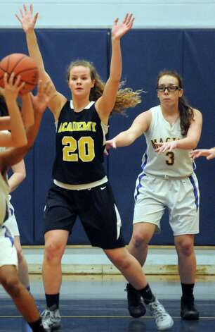 Maginn's Courtney Lane, right, guards Albany Academy's Emili Padalino, left, during their girl's basketball game on Thursday Feb. 5, 2015 in Albany, N.Y.  (Michael P. Farrell/Times Union) Photo: Michael P. Farrell / 10030488A