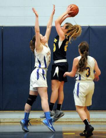 Albany Academy's Emili Padalino goes up for a shot during their girl's basketball game against Maginn on Thursday Feb. 5, 2015 in Albany, N.Y.  (Michael P. Farrell/Times Union) Photo: Michael P. Farrell / 10030488A