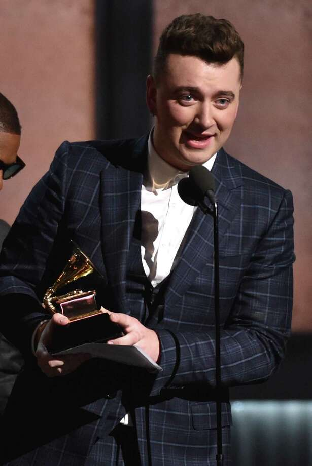 "Sam Smith accepts the award for record of the year for ""Stay With Me"" at the 57th annual Grammy Awards on Sunday, Feb. 8, 2015, in Los Angeles. (Photo by John Shearer/Invision/AP) ORG XMIT: CACJ420 Photo: John Shearer / Invision"