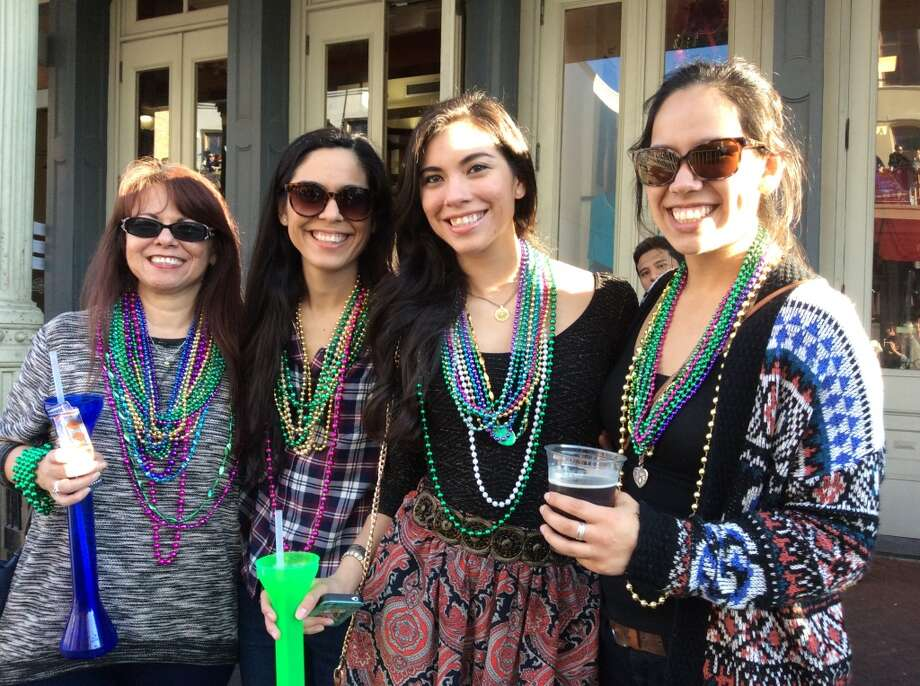 Revelers celebrate Mardi Gras in Galveston Island's historic Strand District on Saturday, February 7, 2015. Photo: Andrea Waguespack/Houston Chronicle