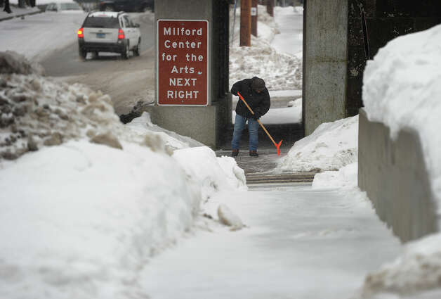 Sleet and snow continues to fall in downtown Milford, Conn. on Monday, February 9, 2015. Photo: Brian A. Pounds / Connecticut Post