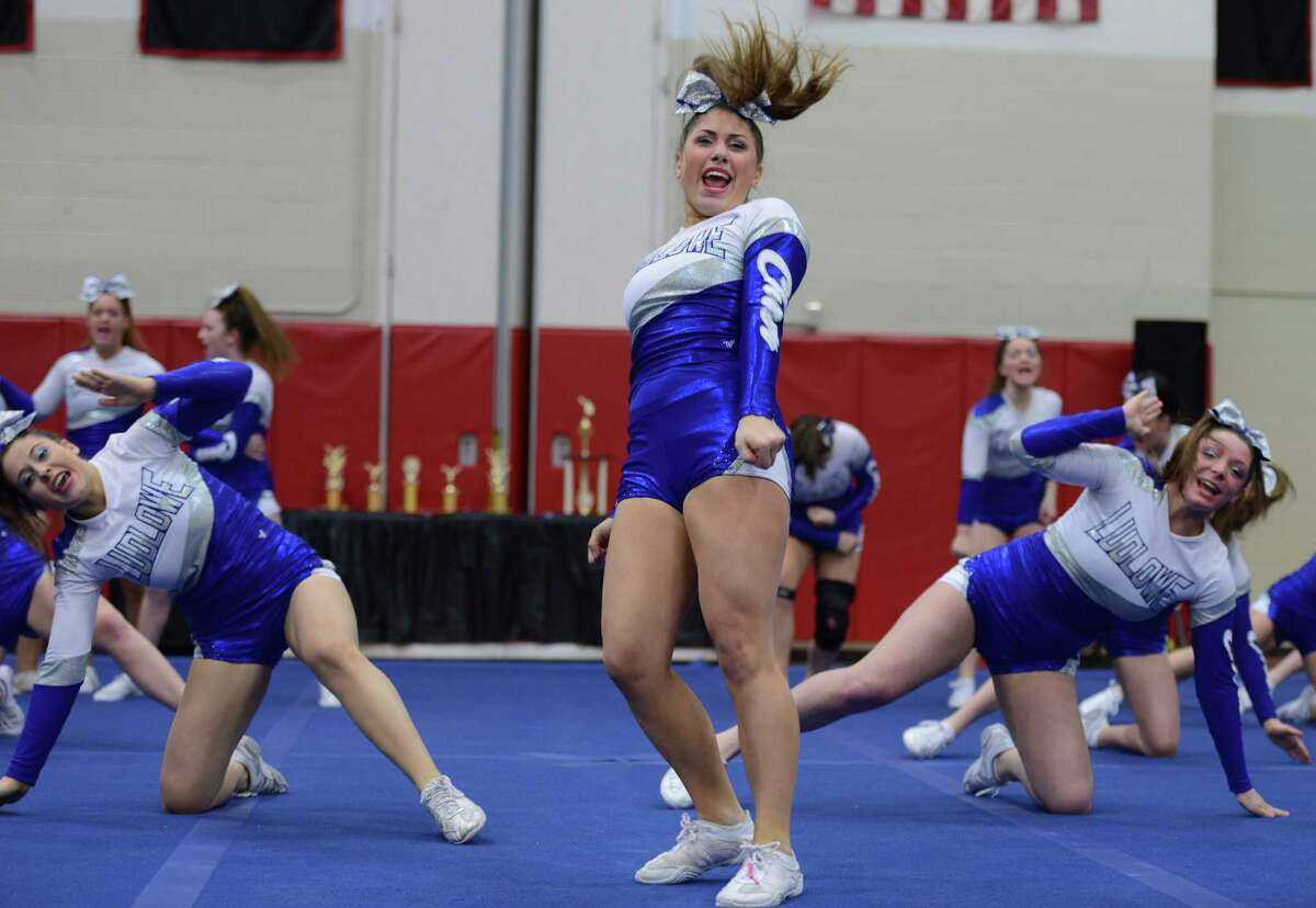 The Ludlowe cheerleading team competes in the 2015 FCIAC Cheerleading championships at Warde High School. The Falcons won the team competition for the third time in four years.