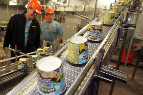 In this photo taken March 23, 2010, ice cream moves along the production line at Ben & Jerry's Homemade Ice Cream  in Waterbury, Vt. Ben & Jerry's is cutting about two dozen jobs at its Waterbury plant as part of a restructuring of its Vermont ice cream making operations.