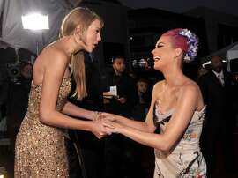 LOS ANGELES, CA - NOVEMBER 20:  Singers Taylor Swift (L) and Katy Perry arrive at the 2011 American Music Awards held at Nokia Theatre L.A. LIVE on November 20, 2011 in Los Angeles, California.  (Photo by Lester Cohen/AMA2011/WireImage)