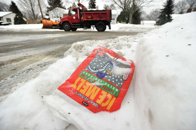 A empty bag of ice melt rests on a snow bank at an East Main Street intersection in Stratford, Conn. on Monday, February 9, 2015. Photo: Brian A. Pounds / Connecticut Post