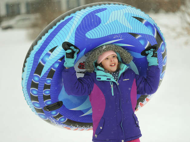 Andrea Pecor, 10, of Stratford, enjoys an afternoon of tubing at Academy Hill in Stratford, Conn. on Monday, February 9, 2015. Photo: Brian A. Pounds / Connecticut Post