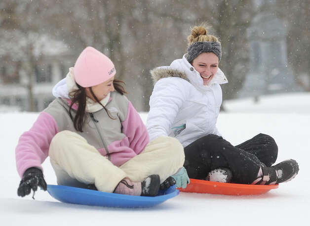 Taylor Reed, left, and Lynn Schneider, both of Stratford, enjoy an afternoon of sledding at Academy Hill in Stratford, Conn. on Monday, February 9, 2015. Photo: Brian A. Pounds / Connecticut Post