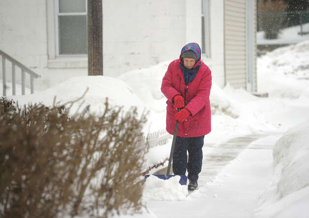 Anna Scollin, 80, of Derby, shovels snow outside her home on 7th Street in Derby, Conn. on Monday, February 9, 2015. Photo: Brian A. Pounds / Connecticut Post