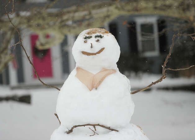 A happy snowman at Academy Hill in Stratford, Conn. on Monday, February 9, 2015. Photo: Brian A. Pounds / Connecticut Post