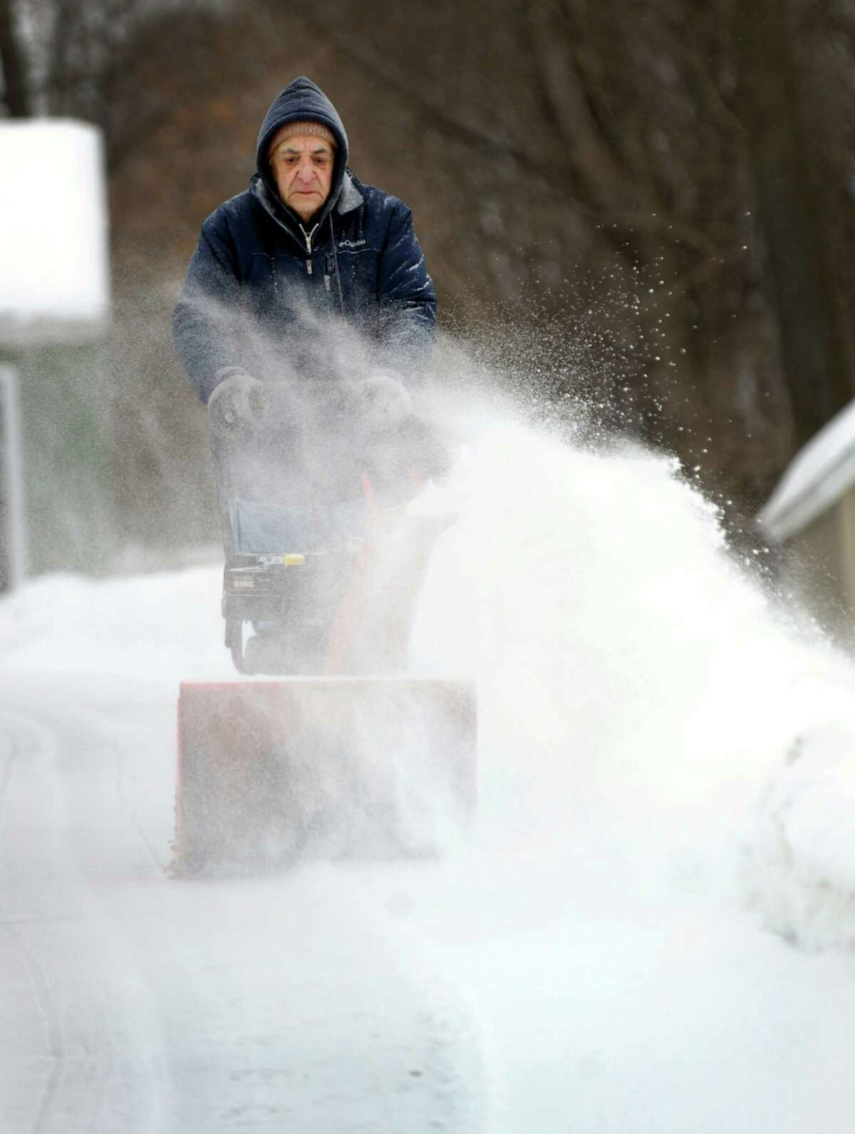 Joseph Rotella, 82, snowblows his driveway on Wooster Street in Danbury, Conn., Monday, February 9, 2015.