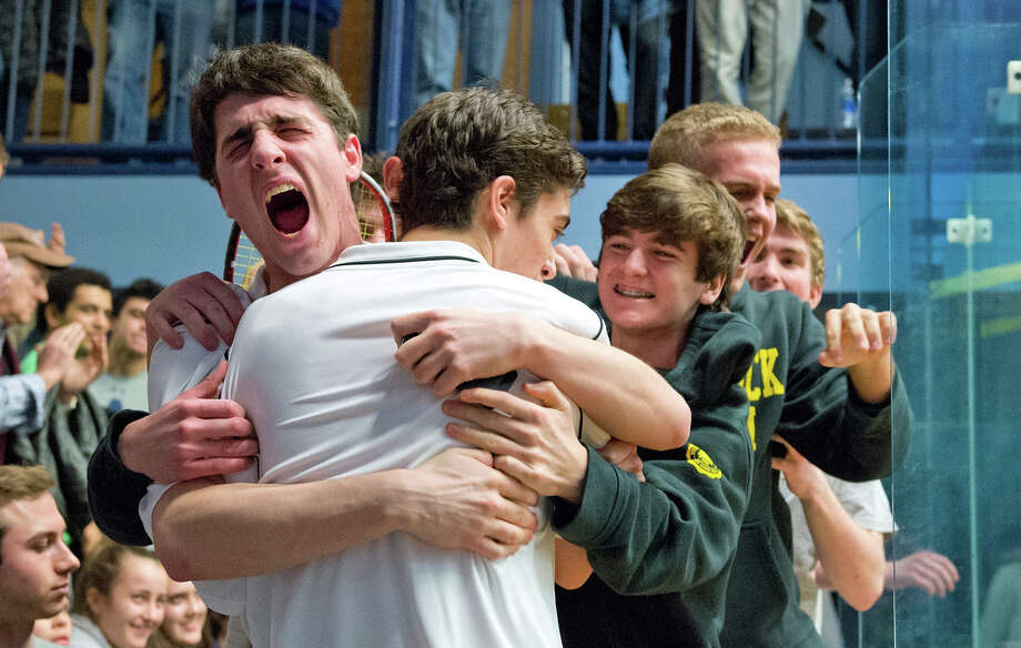 Jarett Odrich, left, hugs David Yacobucci after Yacobucci won the deciding match in Brunswickís 4-3 win over Belmont Hill School in the final of the U.S. High School Team Squash Championships. Photo: Contributed Photo / Greenwich Time Contributed