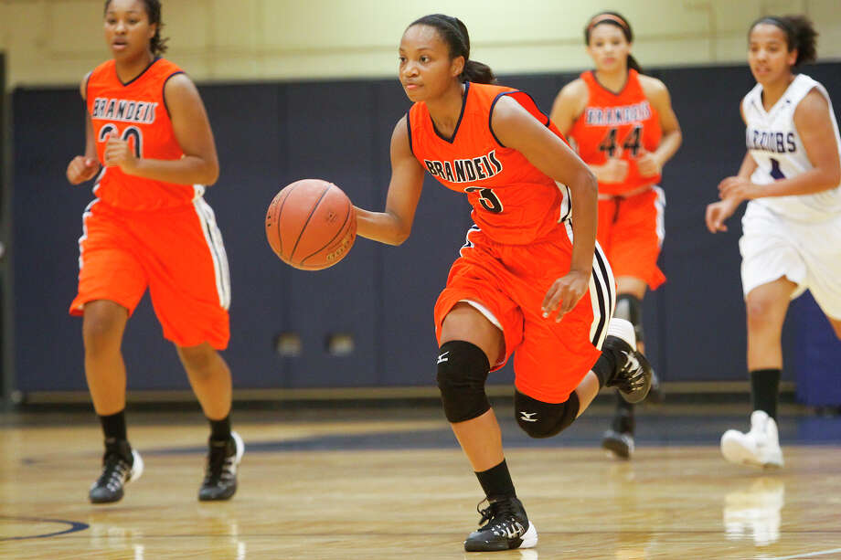 Brandeis' Gabby Connally brings the ball up the court during a 2013 game agaisnt Warren at Taylor Field House. Photo: Marvin Pfeiffer /San Antonio Express-News / Prime Time Newspapers 2013